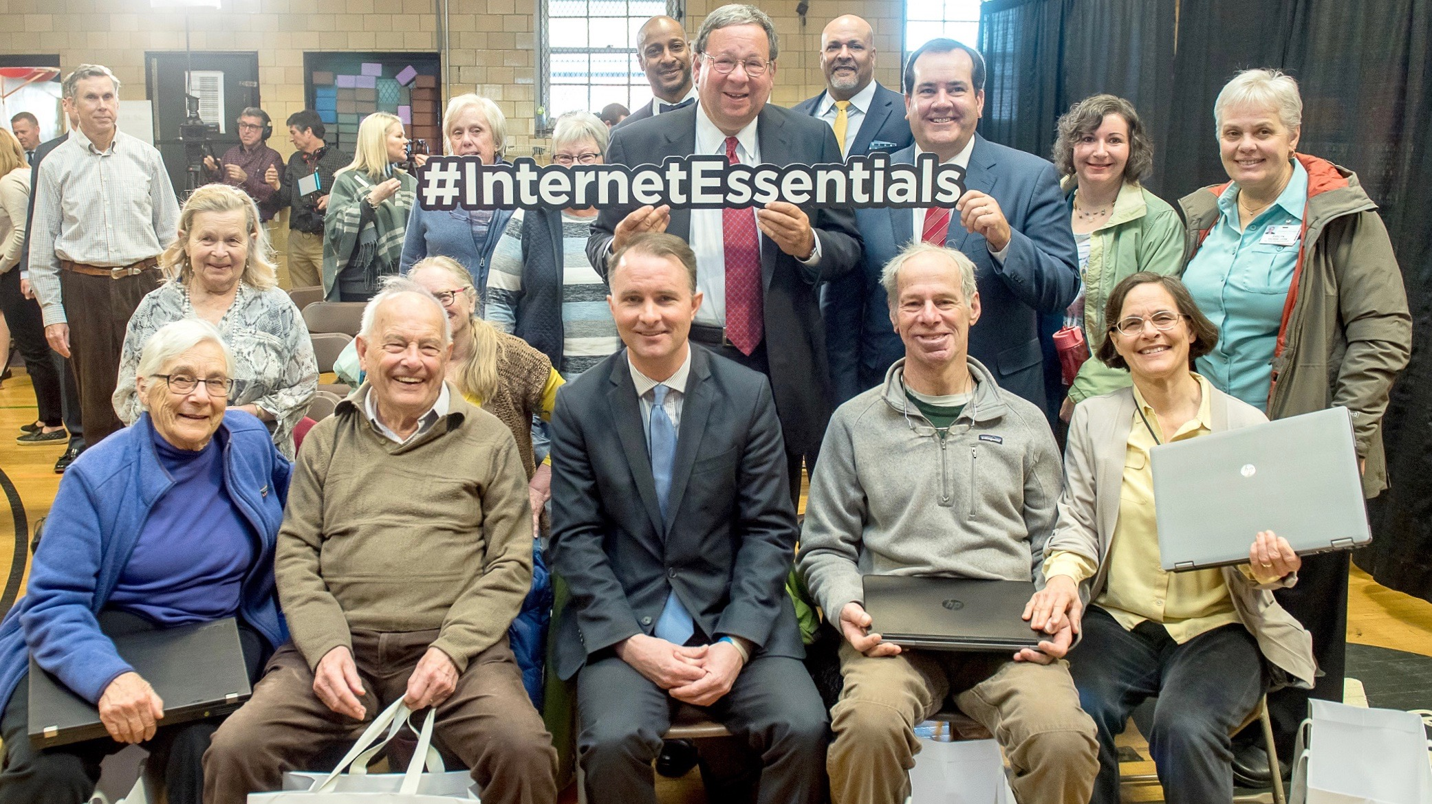 David L. Cohen, Comcast Corporation's Senior Executive Vice President and Chief Diversity Officer, stands with a group of senior Internet Essentials recipients.
